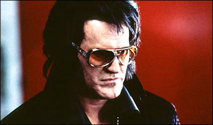 Bruce Campbell as Elvis Presley